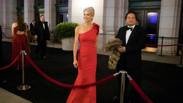 In this Thursday, Jan. 19, 2017 file photo, President-elect Donald Trump adviser Kellyanne Conway, centre, accompanied by her husband, George, speaks with members of the media as they arrive for a dinner at Union Station in Washington, the day before Trump's inauguration. (AP Photo/Matt Rourke)