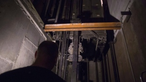 A building manager is pictured in an elevator pit in a downtown Toronto office building on on July 13, 2016. Maintenance contractors would be held responsible for getting broken-down elevators up and running in relatively short order under proposed novel legislation in Ontario that seeks to address what some have deemed a crisis.(File/THE CANADIAN PRESS)