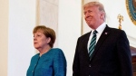 U.S. President Donald Trump and German Chancellor Angela Merkel arrive for a joint news conference in the East Room of the White House in Washington, Friday, March 17, 2017. (AP Photo/Andrew Harnik)