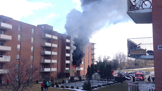Flames and smoke poured out of the second floor of 316 Kathleen Street. (Twitter/ Cam Guthrie)