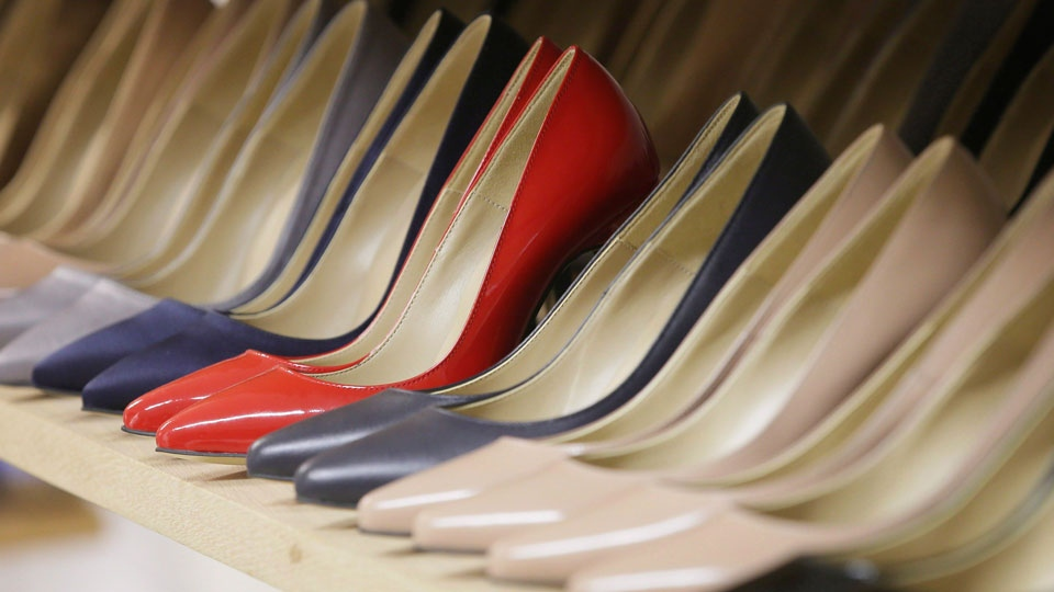 High heels on display in the Pretty Small Shoes store in Bloomsbury, London on March 6, 2017. Servers clad in short skirts and stilettos could soon be a thing of the past, as British Columbia and Ontario take steps to ditch sexualized dress codes. (THE CANADIAN PRESS/AP, Tim Ireland)