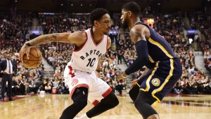 Toronto Raptors guard DeMar DeRozan tries to get past Indiana Pacers forward Paul George during first half NBA basketball action, in Toronto on Sunday, March 19, 2017. (Frank Gunn / THE CANADIAN PRESS)