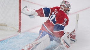 Montreal Canadiens goaltender Carey Price makes a save against the Ottawa Senators during second period NHL hockey action in Montreal, Sunday, March 19, 2017. THE CANADIAN PRESS/Graham Hughes
