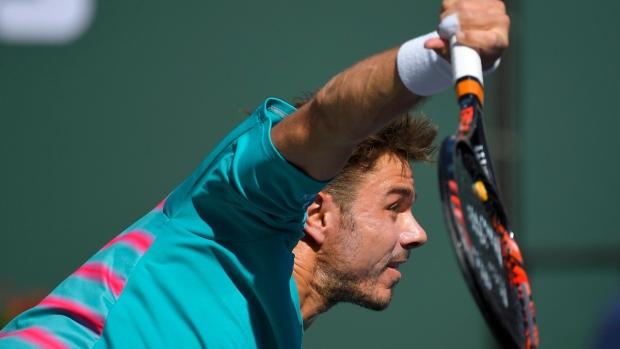 Stan Wawrinka serves to Roger Federer