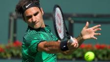 Roger Federer hits to Stan Wawrinka