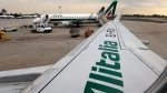 Alitalia planes on the tarmac at Linate airport, in Milan, Italy, on May 7, 2014. (Luca Bruno / AP)