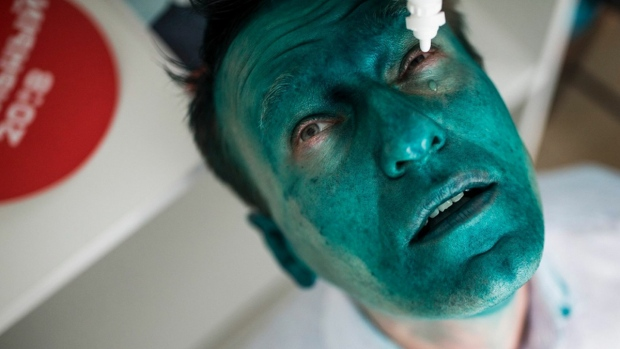 Alexei Navalny with a green face