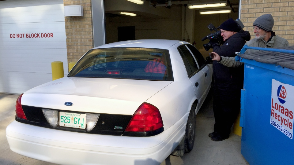 Members of the media photograph Russell Dennis Wolfe as he is driven into Saskatoon's Court  of Queen's Bench on Monday, March 20, 2017. Wolfe pleaded guilty to 20 charges in connection to a child pornography investigation. (Angelina Irinici/CTV Saskatoon)