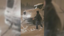 An 18-wheeler towed in snow