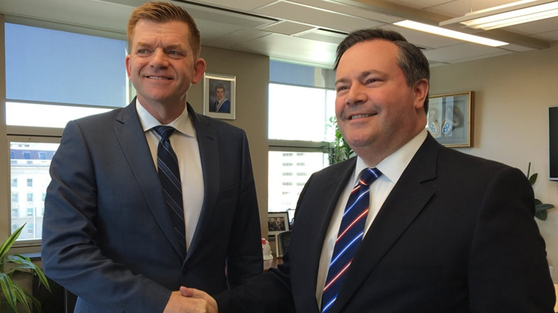 Wildrose Leader Brian Jean and PC Leader Jason Kenney shake hands in a photo released by Kenney on Monday, March 20, 2017. Supplied.