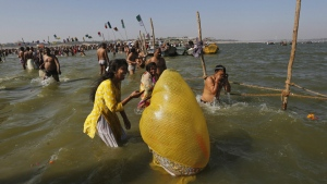 Hindu devotees take holy dips at the Sangam, the confluence of the Ganges and Yamuna and the mythical Saraswati, on the occasion of Hindu festival of Shivaratri, that marked the last day of the annual traditional fair of Magh Mela, in Allahabad, India , Friday, Feb. 24, 2017. (AP / Rajesh Kumar Singh)