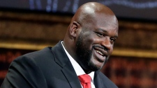 In this Sept. 9, 2016, file photo, basketball Hall of Fame inductee Shaquille O'Neal speaks during induction ceremonies in Springfield, Mass. O'Neal said on the March 20, 2017, edition of his podcast that he believes the world is flat. (Elise Amendola / AP)