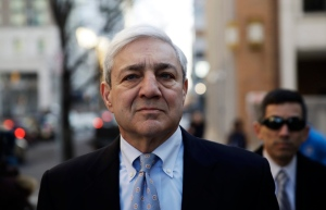 Former Penn State president Graham Spanier walks to the Dauphin County Courthouse in Harrisburg, Pa., Monday, March 20, 2017. (AP Photo/Matt Rourke)
