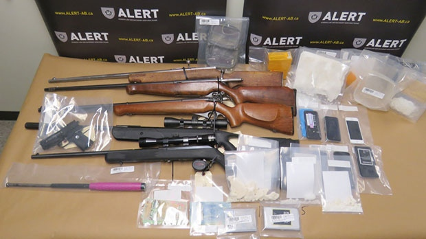 More than $25,000 worth of drugs and four firearms were seized from a home in Fort MacLeod.