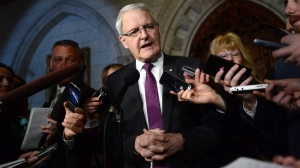 Transport Minister Marc Garneau speaks to reporters in the foyer of the House of Commons on Parliament Hill in Ottawa on Tuesday, March 21, 2017. (THE CANADIAN PRESS/Sean Kilpatrick)