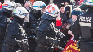 Police hold back protesters during a demonstration regarding motion M-103 in Montreal, Saturday, March 4, 2017. (Graham Hughes/The Canadian Press)