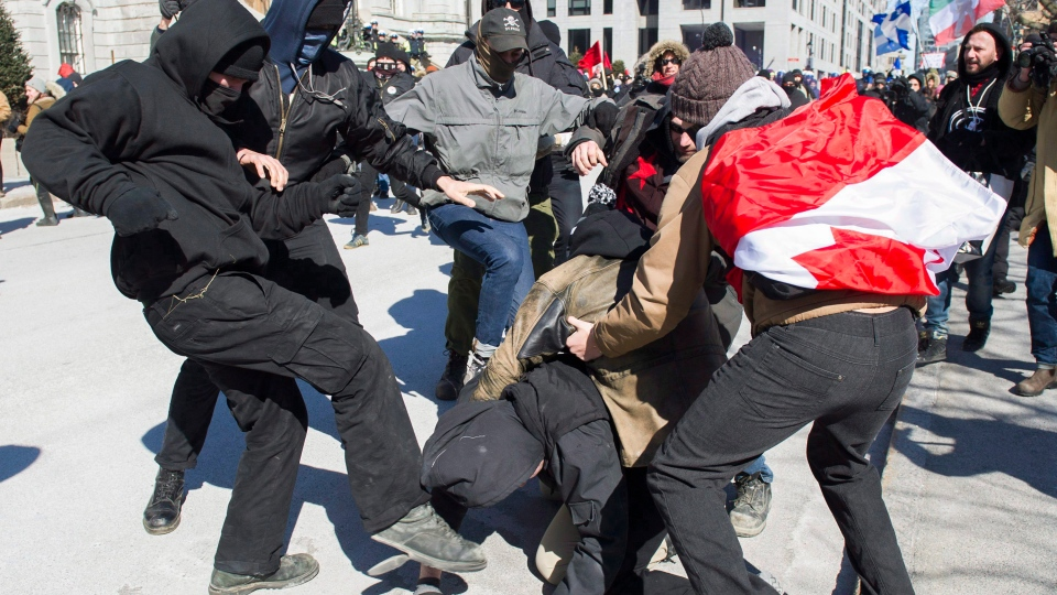Opposing groups of protesters clash during a demonstration regarding motion M-103 in Montreal, Saturday, March 4, 2017. (Graham Hughes/The Canadian Press)