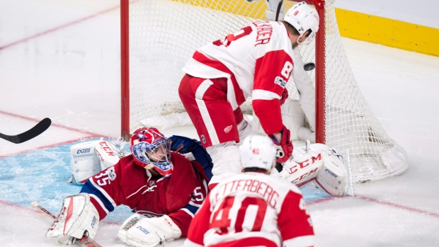 Detroit Red Wing Justin Abdelkader scores on Canadiens goalie Al Montoya on Tuesday, March 21, 2017. THE CANADIAN PRESS/Paul Chiasson
