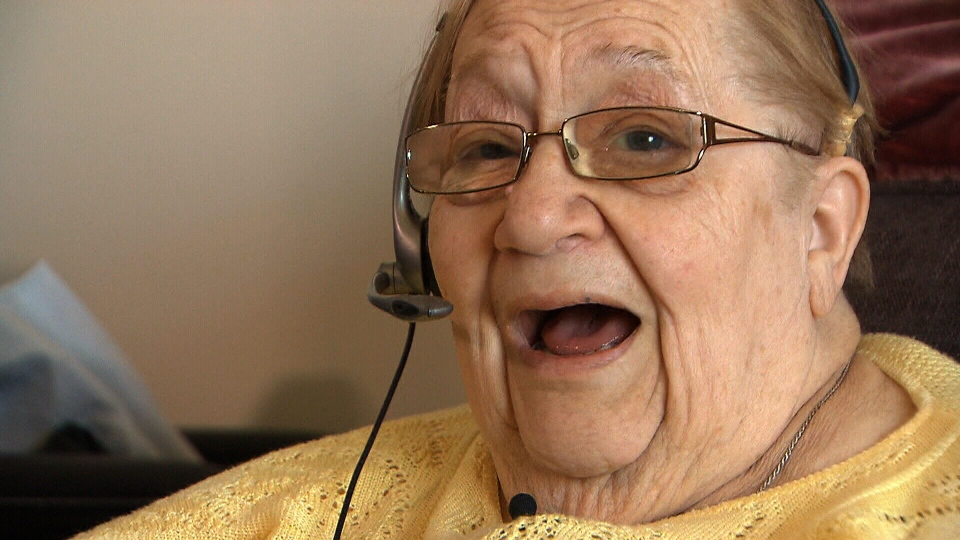 Jean Feliksiak, 86, participates in a call from the Seniors' Centre Without Walls Program in Winnipeg.