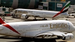 This May 8, 2014 file photo shows Emirates passenger planes at Dubai airport in United Arab Emirates.  (AP Photo/Kamran Jebreili, File)