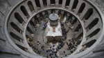 People line to to visit the renovated Edicule in the Church of the Holy Sepulchre, traditionally believed to be the site of the crucifixion of Jesus Christ, in Jerusalem Tuesday, March 21, 2017. (AP / Dusan Vranic)