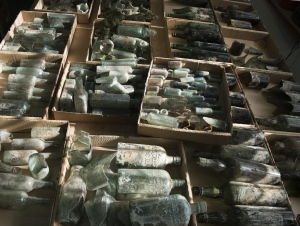 This undated photo provided by the Israel Antiquities Authority on Wednesday, March 22, 2017, shows century-old liquor bottles that belonged to British soldiers in World War I.  (Clara Amit, Israel Antiquities Authority via AP)