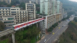 A train in China goes right through the middle of