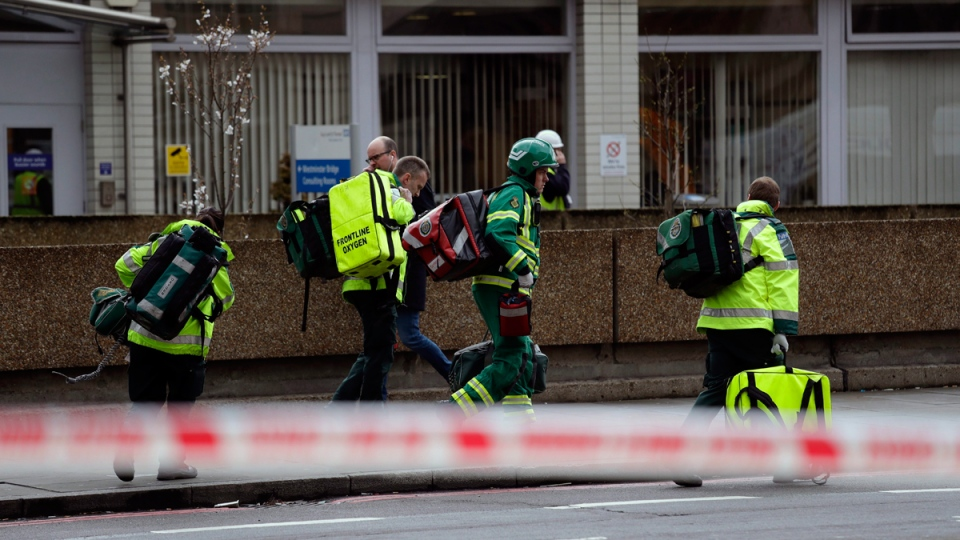 Emergency service workers arrive on the scene close to the Houses of Parliament in London, on March 22, 2017. (Matt Dunham / AP)