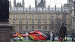 An Air Ambulance on the scene after sounds similar to gunfire have been heard close to the Houses of Parliament, London, Wednesday, March 22, 2017. (Victoria Jones/PA via AP)