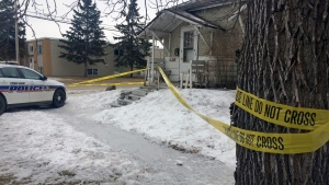 Police tape sits strung around a home on Prince Albert's Ninth Street East on Wednesday, March 22, 2017, after the city's first homicide of the year. (Rebekah Lesko/CTV Saskatoon)