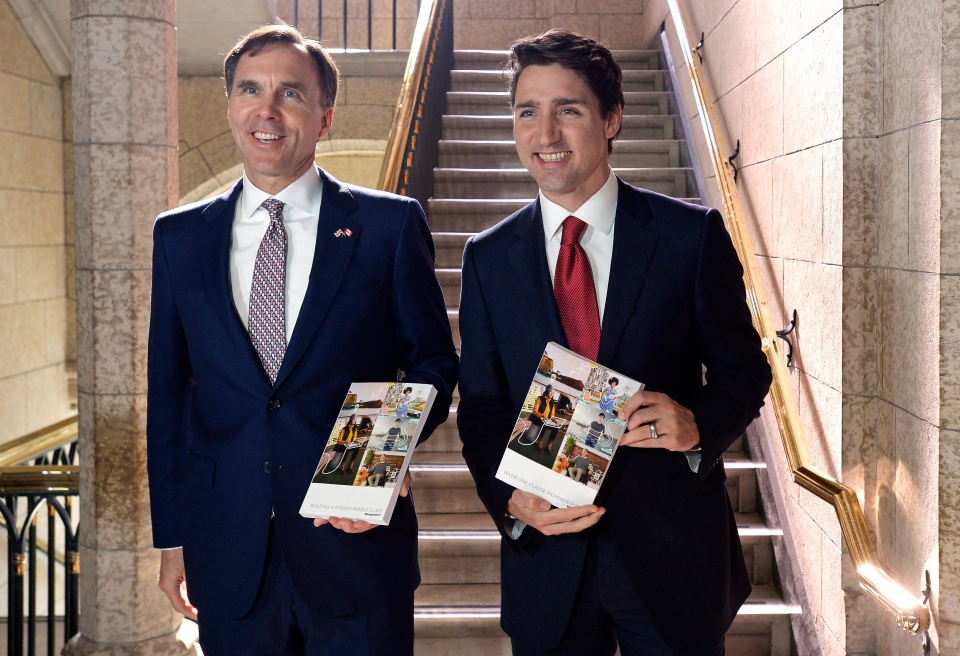 Finance Minister Bill Morneau and Prime Minister Justin Trudeau hold copies of the federal budget in the House of Commons in Ottawa, Wednesday, March 22, 2017. (Adrian Wyld / THE CANADIAN PRESS)