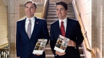 Finance Minister Bill Morneau and Prime Minister Justin Trudeau hold copies of the federal budget in the House of Commons in Ottawa, Wednesday, March 22, 2017. THE CANADIAN PRESS/Adrian Wyld