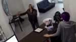 A suspected thief speaks to an employee at Cocoa Tanning Salon in Vancouver in this image taken from surveillance video. (CTV)