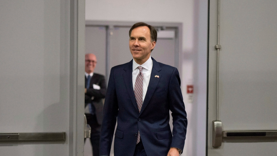 Minister of Finance Bill Morneau arrives for a press conference at the media lock-up, before tabling the budget in the House of Commons on Parliament Hill, in Ottawa on Wednesday, March 22, 2017. (THE CANADIAN PRESS/Justin Tang)