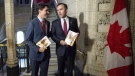 Prime Minister Justin Trudeau, left, speaks with Finance Minister Bill Morneau as he arrives to table the budget in Ottawa in a March 22, 2016, file photo. (Justin Tang / THE CANADIAN PRESS)