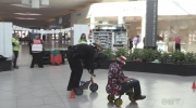 Racing around Conestoga Mall on tiny tricycles