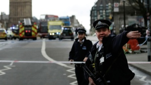 Police secure the area on the south side of Westminster Bridge close to the Houses of Parliament in London, Wednesday, March 22, 2017.  (AP Photo/Matt Dunham)