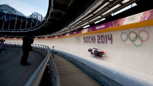 Canadians Tristan Walker and Justin Snith race in the first of two races to end up with a 4th place finish in the Men's Doubles Luge at the Sochi Winter Olympics in Krasnaya Polyana, Russia, Wednesday, Feb. 12, 2014. (Jonathan Hayward/The Canadian Press)