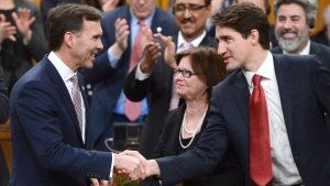 Prime Minister Justin Trudeau shakes hands with Minister of Finance Bill Morneau after he delivered the federal budget in the House of Commons on Parliament Hill in Ottawa, Wednesday March 22, 2017. THE CANADIAN PRESS/Sean Kilpatrick