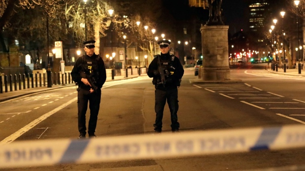 Two policemen stand guard at a cordoned off area on the way to the Houses of Parliament in central London, Wednesday, March 22, 2017. (AP Photo/ Matt Dunham)