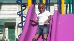 Reginald Kendall Harris Jr. is seen playing on a slide at a park in Portland, Ore. In July 2016. (Pamela Harris)