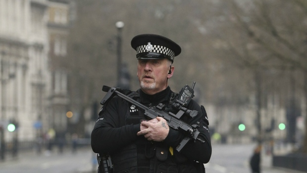 A police officer patrols around Whitehall, the day after a terrorist attack in London, Britain on Thursday March 23, 2017. (Jonathan Brady / PA)
