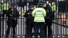 Armed police officers stand at the gates of Downing Street in London, Thursday March 23, 2017 on her way to the House of Parliament. On Wednesday a man went on a deadly rampage, first driving a car into pedestrians then stabbing a police officer to death before being fatally shot by police within Parliament's grounds in London. (AP Photo/Kirsty Wigglesworth)