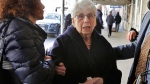 Ronnie Eldridge, widow of journalist Jimmy Breslin, arrives for his funeral at the Church of the Blessed Sacrament in New York, Wednesday, March 22, 2017. (AP Photo/Richard Drew)