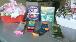 The baskets contain everything from necessities such as bibs or diapers to toys for the newborn to play with.
