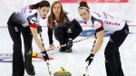 Canada's Lisa Weagle, left, and Joanne Courtney, right, sweep a path for the stone as Rachel Homan, center, watches during their match against Italy in the CPT World Women's Curling Championship 2017 in Beijing, March 23, 2017. (Mark Schiefelbein / AP)