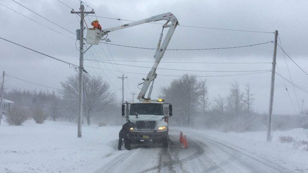 Nova Scotia Power crews work to restore power in the Sydney area on March 23, 2017.