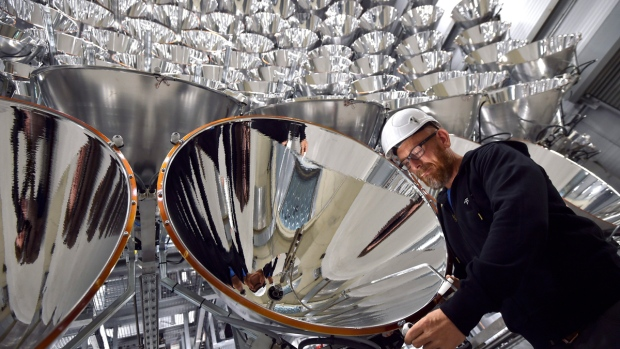 Engineer Volkmar Dohmen in front of xenon short-arc lamps in the DLR German national aeronautics and space research centre in Juelich, Germany, on March 21, 2017. (Caroline Seidel / dpa via AP)