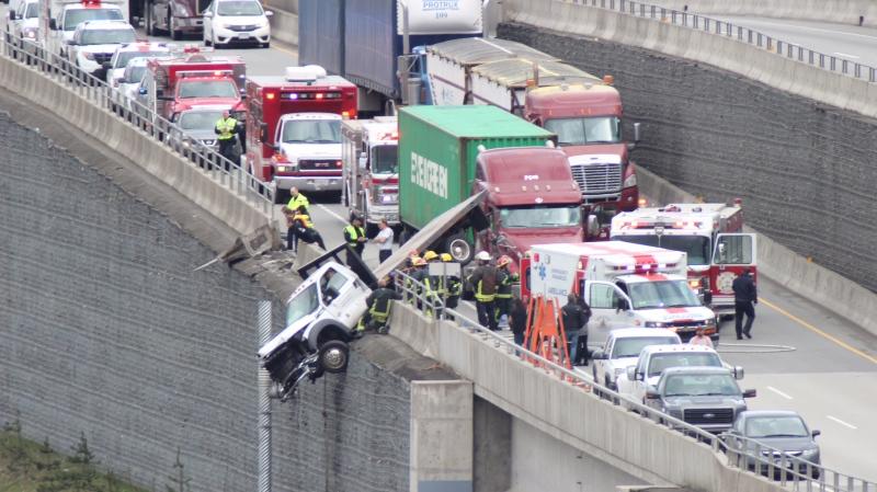 A crash on Highway 17 left a flatbed truck dangling Thursday afternoon. (CTV)