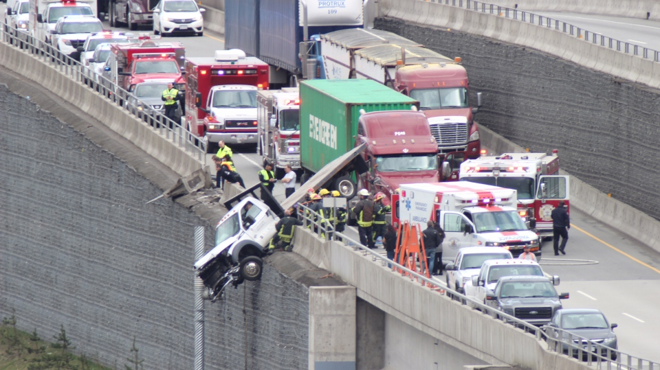 A crash on Highway 17 left a flatbed truck dangling Thursday afternoon. (CTV)
